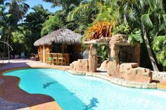 Grotto style custom pools brings a private island oasis to your own back yard.