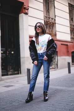 Coco Cuba. T-shirt with print+straight cropped jeans+black plattform heeled ankle boots+black padded jacket+sunglasses. Winter Casual Outfit 2017