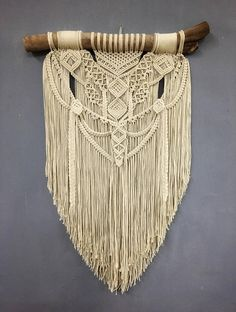 **This piece has sold** If you purchase this listing, you are placing a custom order for a replica. Please keep in mind that your end product might differ slightly from the images above. Size is approximately: Driftwood: 50 cm (19) Macrame length: 80 cm (31) Material: Cotton rope,