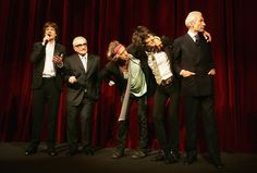 (From L to R) Rolling Stones Singer Mick Jagger, director Martin Scorsese, guitarist Keith Richards, bassist Ronnie Wood and drummer Charlie Watts speak to the public shortly before the premiere of 'Shine A Light' at the Opening Ceremony as part of the 58th Berlinale Film Festival at the Berlinale Palast on February 7, 2008 in Berlin, Germany.