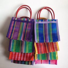 These mini mexican mercado bags can be used as gift bags or fiesta favors. You can fill them with goodies, a little note or a gift, or you can use them as decoration for your next fiesta, bachelorette party, wedding or any party!  These bags are made in Mexico and made from recyclable plastic mesh. Each bag measures approximately 5 3/4 inches high x 5 1/4 inches width x 4 inches wide.  Assorted colors only. All orders are shipped using Mexican Postal Service and it takes: 15-25 bussines days…