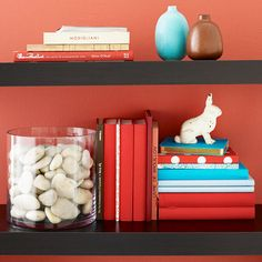 Creative July 4th Shelf Decorations    Turn everyday items into a red, white, and blue 4th of July shelf display. Fill a glass vase with white stones or seashells. Wrap books in each patriotic color, and accent with vases or figurines in holiday colors.  Editor's Tip: If red, white, and blue bound books aren't available, fold construction paper over the covers.