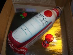 Vodka Bottle Cake - Bottle of Ciroc Vodka for birthday party. Red velvet cake with cream cheese flavored swiss meringue buttercream filling.