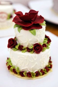 For an elegant, over the top dessert, consider a white two-tier cake with edible red flowers.