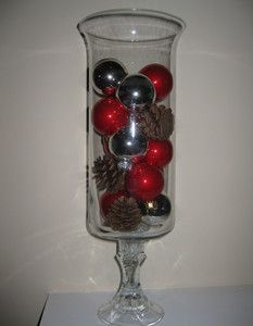 Dollar Store Glass Hurricanes DIY Christmas Decorations. Would also work for center pieces for a wedding!