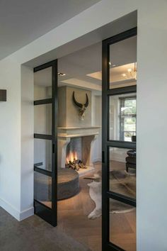 Love the white walls, black trimmed sliding doors and warm lighting.