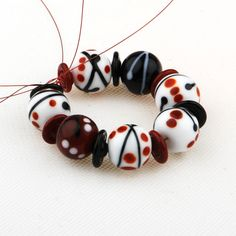 Handmade Lampwork glass bead set  (15)  - Urban Kiss  - Black Red White  -  SRA   UK. £36.00, via Etsy.