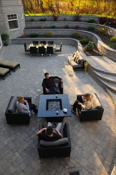 Roman pavers and Roman Pisa transform this patio into an inviting backyard space