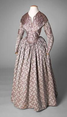 Cartridge pleated skirt, long waist, slopping shoulder. Circa 1845