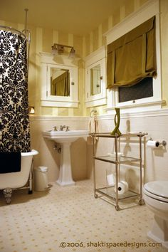 Love the black and white damask shower curtain and the yellow striped wallpaper!