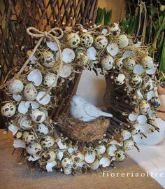Fioreria Oltre/ Easter wreath arrangement with quail eggshells https://it.pinterest.com/fioreriaoltre/fioreria-oltre-easter/