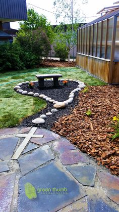 Rosary garden made for a Catholic elementary school. Using round washed rocks to create the rosary beads and a concrete cross cut into the flagstone we created a unique prayer garden for the children.