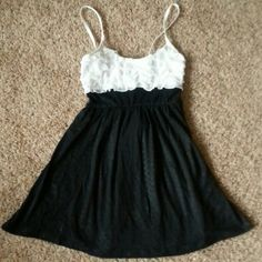 Ruffled Tank Top Black with white ruffled top tank with elastic waist and ties in back rayon and spandex Body Central Tops Tank Tops
