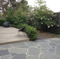 Garden design by Lisa Ellis Gardens.  Curved deck, curved wall and crazy paving in an inner northern suburb of Melbourne.  Designed and built 2011-12. Love the crazy paging here.