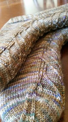 Drachenschwingen by Scarlet Plume, knit in Denali by Pagewood Farms in the Woodsey colorway.