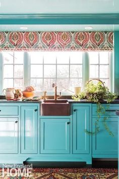 Glossy turquoise cabinetry and brass accents create a jewel box vibe in this lively kitchen.