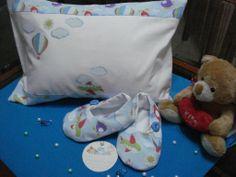 Zapatito y almohadas para el bebe