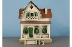 A Schönherr red-roofed dolls' house 1920s, white painted with green doors, lintels and shutters,