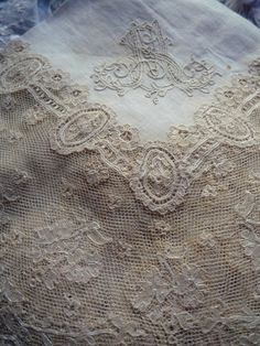 lace edging on embroidered linen