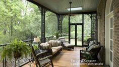 Lovely wrought iron railings on this screened porch