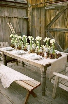 rustic loveliness: pine cones but in vases add baby's breath! Beautiful!
