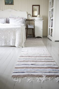 Rag rug runner on painted wood bedroom floors