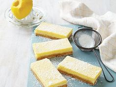 Butter-Crunch Lemon Bars | A buttery, crunchy pastry crust forms the base for a tangy lemon filling. You can substitute fresh orange juice and grated orange rind for lemon, if you wish. These are best served chilled.