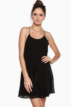 Thin straps add a classic yet sexy twist to this short and simple dress.