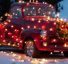 Old vintage truck decorated in red lights for Christmas