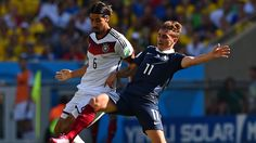 RIO DE JANEIRO, BRAZIL - JULY 04: Sami Khedira of Germany and Antoine Griezmann of France compete for the ball during the 2014 FIFA World Cup Brazil Quarter Final match between France and Germany at Maracana on July 4, 2014 in Rio de Janeiro, Brazil. (Photo by Matthias Hangst/Getty Images)
