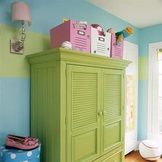repurposed entertainment armoire for the girls' room.