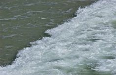 Roiling water; wave rolling shoreward; Glenelg, South Australia, Australia.  January 2014.