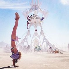 burning man yoga Loved and Pinned by www.downdogboutique.com to our Yoga community boards
