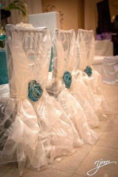 Tiffany Blue Rosettes on white chair covers and tiffany blue table linens for a gorgeous wedding reception decor Tiffany Blue Wedding Ideas.-- not the blue exactly, but HOLY MOLY that design is beautiful Wedding Chairs, Wedding Reception Decorations, Wedding Table, Wedding Ideas, Wedding Favors, Petals Florist, White Chair Covers, Party Chair Covers, Just In Case