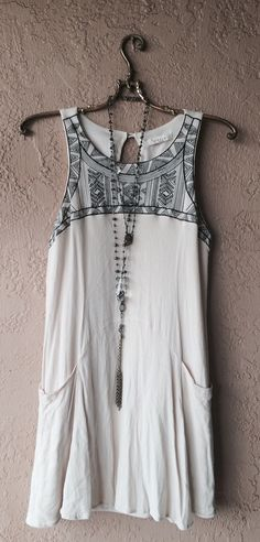 Entro Italian made designer romper dress with pockets and black embroidery details