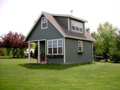 Town and Country Plans, The Whitehorse II. First floor, 236 sf. Loft,142 sf. Porch 52 sf. 16' x 18' total footprint.