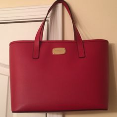 Michael lots jet set leather travel tote Beautiful Michael kors jet set small travel tote in red leather. Brand new with original tags Michael Kors Bags