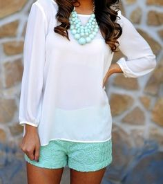 green shorts + solid white long sleeve shirt + short statement necklace