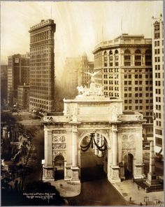 A view of the World War I victory arch astride Fifth Avenue.  We are looking downtown in the direction of the Flatiron Building; Madison Square Park is to the left of the arch, out of view in this photo.  Constructed in 1919, the temporary structure was dismantled the following year.  Photo by Irving Underhill, via the Library of Congress.