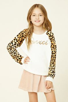"""Forever 21 Girls - A knit sweatshirt featuring leopard print long sleeves, a round neckline, and a glittery """"Merci"""" graphic on the front."""
