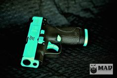 "Tiffany Blue M&P Shield with laser etched ""M"" monograph on the slide. www.madcustomcoating.com www.facebook.com/madcustomcoating"