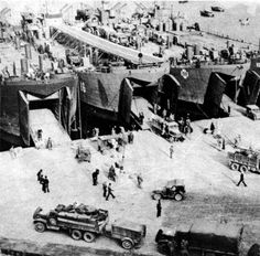 Loading LSTs in Naples for the landing at Anzio, Italy, January 1944. Trucks and jeeps were combat loaded, ready to roll-off and fight upon arrival.