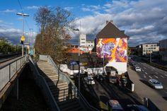 3Steps | Battle Royal | Lion | mural | snake | orange | colours | colors | fight | battle | Giessen | Germany | streetart | Art | sky | urban | train station | sunny | graffiti | rivertales | flussgeschichten | eagle | girl