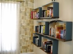 have you ever considered using old draws as book shelves or using pages of a book for wall paper? pretty cute idea