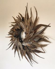 Spiral Pheasant Feather Wreath More Feather Wreath, Feather Crafts, Feather Art, Turkey Feathers, Pheasant Feathers, Wreath Crafts, Wreath Ideas, Autumn Home, Holiday Wreaths