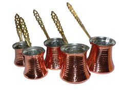"Turkish copper coffee pots - Cezve, served after meals with chewy Turkish sweets.  A famous Turkish proverb says that coffee should be ""as black as hell, as strong as death and as sweet as love."""