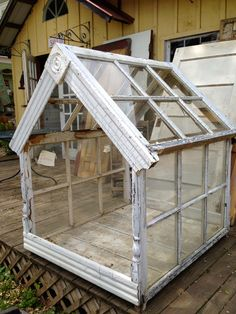 Love this idea for a greenhouse made out of old windows and trim pieces! Going green for sure! <3