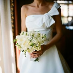 love the bouquet and the one shoulder dress!