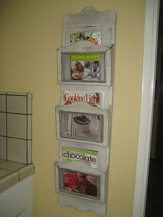 magazine rack for cookbooks in the kitchen.  great decorating + organizing combined.