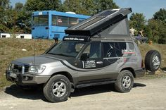 Toyota Land Cruiser 100 converted for camper top with headroom